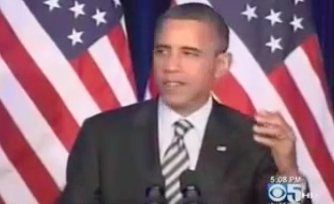 Obama in front of American Flags