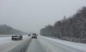 Snow laying on I-295 during a December 2013 snow storm.