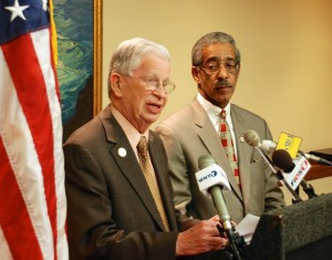 Thompson (left) calls for an investigation while Rice listens at Thursday's press conference