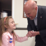 Tom MacArthur greets a young supporter