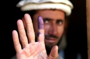 An Afghan elder votes in 2009.