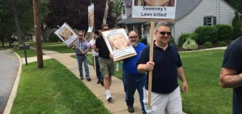 Carol Bowne protesters walk sidewalk in front of Sweeney's home