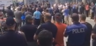 VIDEO: Crowd cheers as injured A.C. officer released from hospital