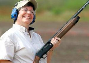 Janet Napolitano Holding Gun
