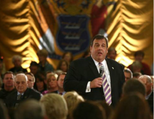 Christie at town hall with NJ Flag