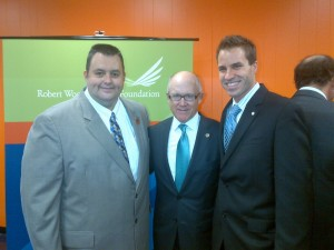 Highlands Mayor Frank Nolan, Jets owner Woody Johnson, and Douglas Eagles, Executive Director of the Boys and Girls Clubs of Monmouth County.