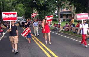 MacArthur (center back) and supporters walk in Riverton 4th of July Parade