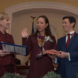 DeCastro (center) sworn into office by LG Kim Guadagno.